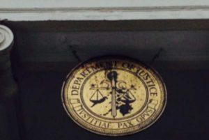 DoJ's official emblem over the front entrance of the building.